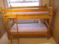 Wooden bunk bed / two single beds with mattresses