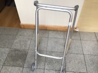 New/unused Zimmer frame with 2 wheels at front for easy glide -£20