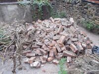 Broken old red bricks and rubble