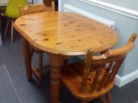 Extending pine dining / kitchen table and 2 matching chairs in very good condition