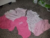 Baby grows for a girl and vests
