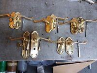 Five Brass door handles