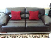 Nearly new brown leather sofa