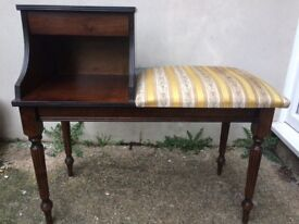 Beautiful telephone table in excellent condition. Slight aging to the upholstery.
