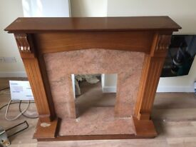 Timber electric fire surround.