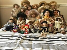 Collection of porcelain & other dolls 40 plus in total. Cabinet included if wanted
