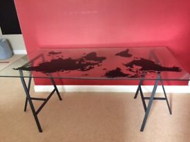 Large glass desk with black map of world superimposed. Excellent condition.