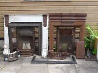 Two Victorian fireplaces, one surround and accessories including a fender all cast iron.