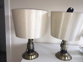 Two cream table lamps
