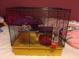 Hamster cage only a couple of months old comes with water bottle and food bowl and wheel