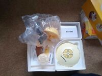 New medela swing electic breast pump and medela store and feed bottles