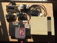 Nintendo NES + 3 controllers + 5 games