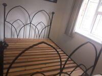 Kingsize black iron bed - available immediately