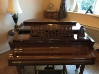 Waldberg baby grand piano avaliable for sale in Torquay.