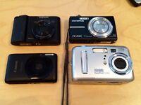 4 x digital cameras. Kodak. Samsung. Olympus. Canon