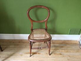 Antique bedroom chair with cane seat