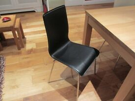 6 modern dining chairs - 2 black and 4 cream. Great condition