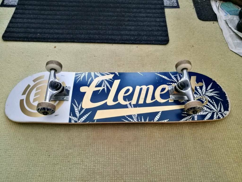 Element Skateboard with small size helmet with knee and elbow pads