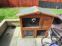 Two tier rabbit hutch with run and rain cover.