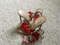 Beautiful high heel shoe, red rose detail and ribbon
