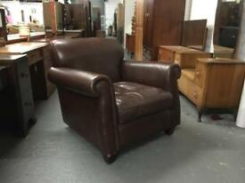 ** BROWN LEATHER ARMCHAIR **