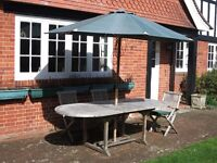 Teak Garden Table and Sun Brolly plus 3 teak chairs if required