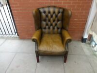 A Brown Leather Chesterfield Library Arm Chair