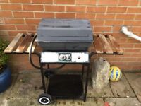 Gas fired barbecue trolley.