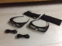 Two Sony 3D active glasses with charging cables