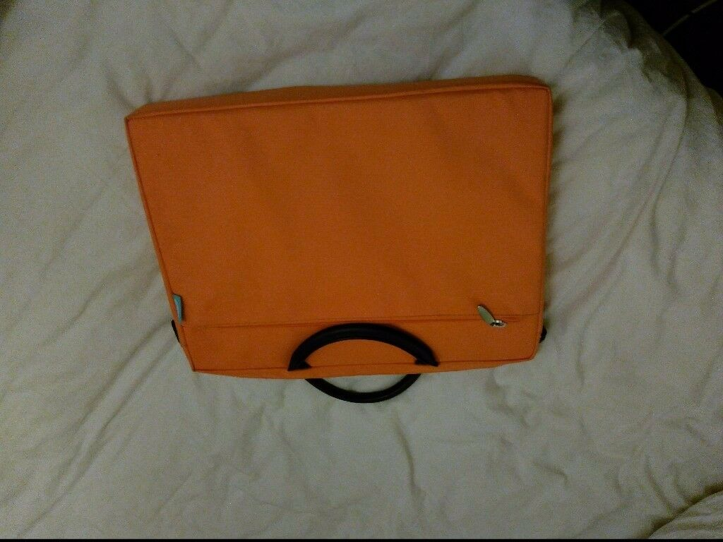 For sale: Brand new orange laptop case, never used