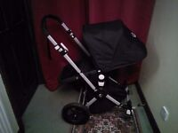 Bugaboo Cameleon 2 in black with lots of accessories!