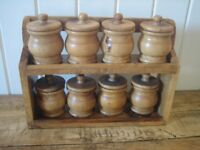 Set of 8 wooden storage jars/spice jars and stand. Lovely condition. Country kitchen style.