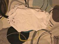 White newborn vests