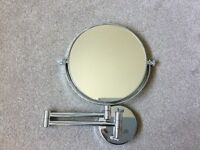 Magnifying extendable mirror