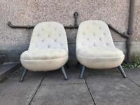 Pair of egg style chairs with Harris tweed upholstery finish