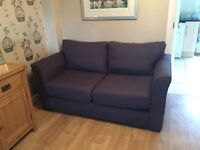 Two seater sofa bed and armchair