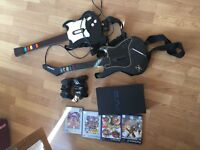 PlayStation 2 console, 2 controllers, 2 guitars and 4 games