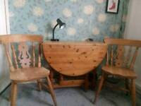 Solid pine table and two chairs