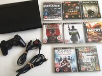 Sony PS3 Super Slim 500GB + Controller + 8 Playstation 3 Games GTA IV Assassins Creed Farcry & More