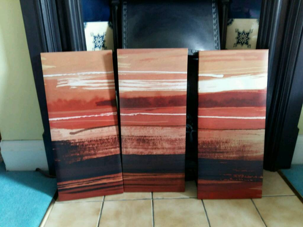 Set of three red sunset printed canvas from Next