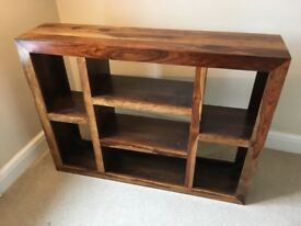 Dark wooden shelving unit