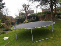 large 12 foot trampolene without safety guard on springs
