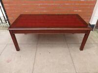 A Red Leather Inlay Glass Coffee Table