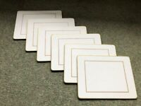 Gold edged table mats