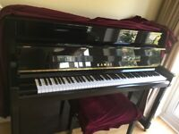 Kawai K200 upright piano finished in black polyester with chrome fittings