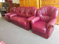 Red leather three seater sofa with matching armchairs