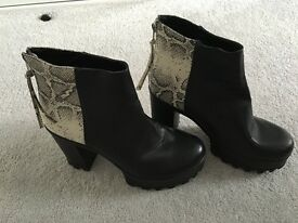 2 pairs of size 8 boots