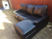 Black L shape corner sofa