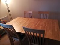 Solid beech dining table and 4 chairs.