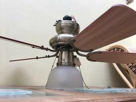 Ceiling light fitting with fan